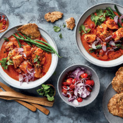 Tomato-and-yoghurt fish curry with green beans and Indian fried bread