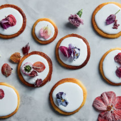 Condensed milk cookies with royal icing and edible flowers
