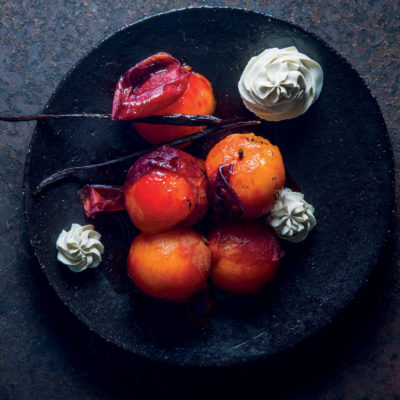 Spicy poached plums with whipped crème fraîche