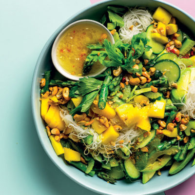 Cold Asian salad with noodles, cucumber, avocado and mango