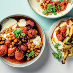 Potato skins with cold blistered tomatoes, yoghurt and chilli chickpeas