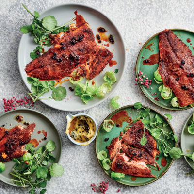Blackened trout with currant butter and lemony Brussels sprouts