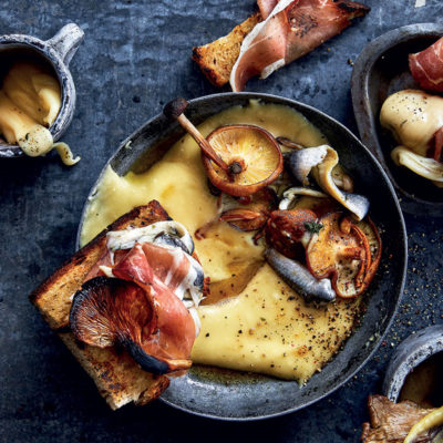 Brandy-roasted exotic mushrooms with fondue and anchovy-and-speck toast