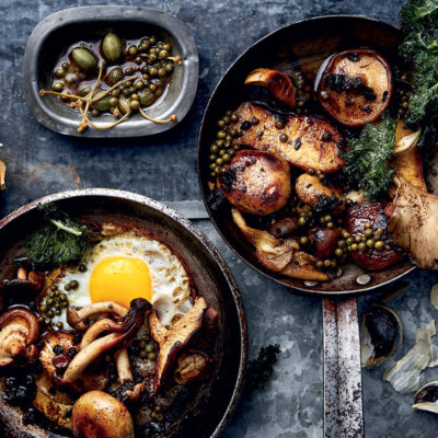Caramelised black garlic butter-based mushrooms with caper brine and fried egg