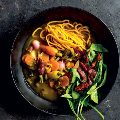 Butternut noodle and carrot soup with spinach-and-bacon salad