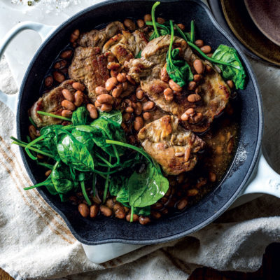 Marinated porks steaks with beans and spinach