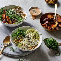Spinach-and- cauliflower noodles with macadamia yoghurt-and-green olive sauce and caponata-style brinjals