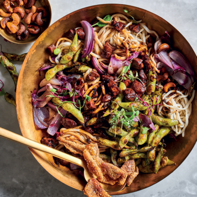 Udon noodles with sticky glazed chicken and charred edamame beans