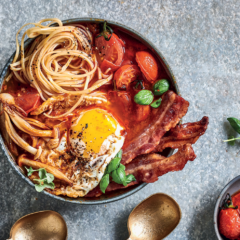 Breakfast egg noodle bowls with fried eggs, bacon, roast tomatoes and mushrooms