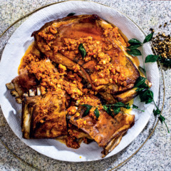 Whole roast lamb ribs with romesco sauce