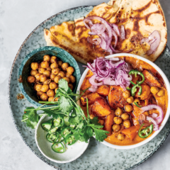Butter chickpea and sweet-potato curry with naan