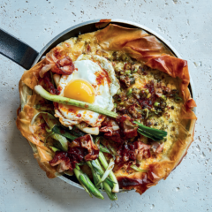 Leek-and-pancetta skillet breakfast tart with crispy harissa-fried eggs