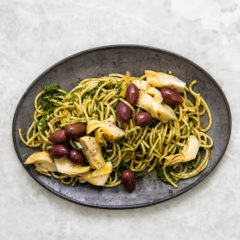 Spaghetti with basil pesto, olives and artichokes