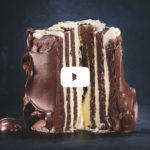 Gluten-free chocolate striped Swiss roll cake