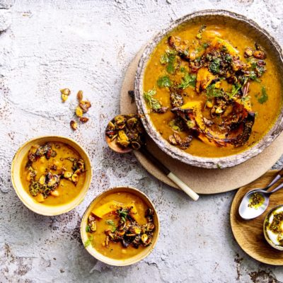 Spicy squash soup with carrot-top pesto
