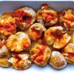 salt baked potatoes with harissa butter