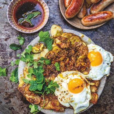 Breakfast potato cakes with crispy fried eggs