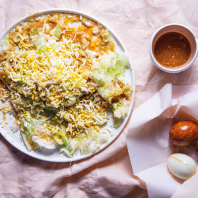 Smashed cabbage with smoked eggs