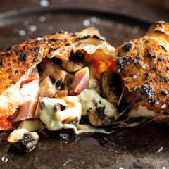 Mini ham-and-mushroom calzones