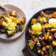 Sausage potato hash with poached eggs