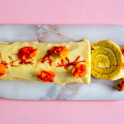Saffron Swiss roll with whipped cardamom cream