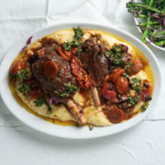Easy venison shanks, creamy polenta and charred Tenderstem broccoli