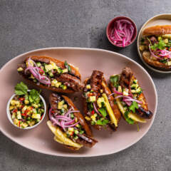 Loaded boerie rolls with pineapple salsa