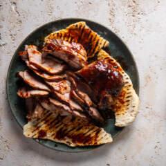 Smoky pork rib-eye steaks with flatbreads