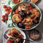potato cakes with tomatoes and mushrooms